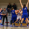 Winnacunnet's #20 Danielle Boucher tries to hold onto her rebound with Salem's #23 Kristen Giuffre looking to get a turnover during Wednesday's NHIAA DIV I preliminary playoff Girls Basketball game between Winnacunnet and Salem High Schools on 3-1-2017 @ WHS.  Matt Parker Photos