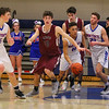 Winnacunnet's #11 Liam Vivano dribbles through traffic while pushing the ball up the court during Tuesday's NHIAA DIV I First Round Playoff game between Winnacunnet and Alvirne High Schools on 3-7-2017 @ WHS. Matt Parker Photos