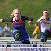 Winnacunnet's Caitlin Capezzuto clears a hurdle in the girls hurdle event at Tuesday's dual track meet between Winnacunnet and timberlane High Schools on 4-18-2017 @ WHS.  Matt Parker Photos