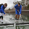 Winnacunnet's Mark Fagan and Dylan Taylor work to squeegee the court after brief showers delayed play at Friday's NHIAA DIV I Boys Tennis match between Winnacunnet and Memorial high Schools on 4-7-2017 @ WHS.  Matt Parker Photos