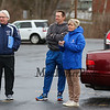 (L to R) Memorial's Boys Tennis Coach Christopher Meehan with Winnacunnet's coach Tom Hayward and Athletic Director Carol Dozibrin waiting for the courts to dry to complete Friday's NHIAA DIV I Boys Tennis match between Winnacunnet and Memorial High Schools on 5-7-2017 @ WHS.  Matt Parker Photos