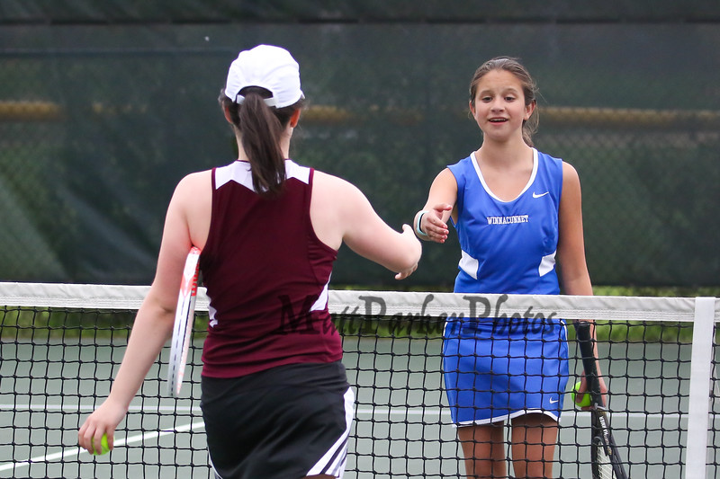 Winnacunnet's Megan Pike shakes the hand of Derryfield's Caroline Desmarais after her win in the #6 singles match during Wednesday's NHIAA DIV I Girls Tennis Match between Winnacunnet and Derryfield School on 5-10-2017 @ WHS.  Matt Parker Photos