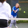 Winnacunnet's Emily Walts makes a backhand shot with Derryfield's Miranda Shilliing covering the net in the #1 doubles match at Wednesday's NHIAA DIV I Girls Tennis Match between Winnacunnet and Derryfield School on 5-10-2017 @ WHS.  Matt Parker Photos