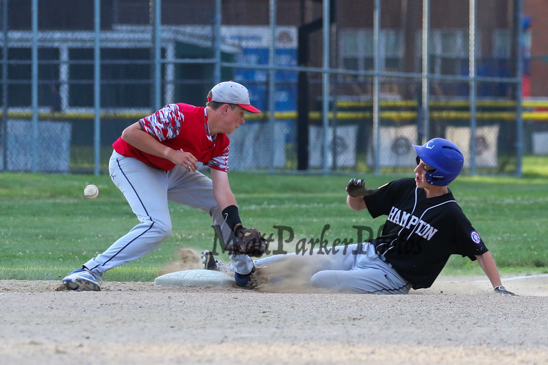 Hampton Black's #15 Kevin Coates slides safely into 3rd as the ball pops out of the glove of Exeter Red's #27 Kevin Bowe's glove at Monday's 1st Round Seacoast Baseball U13-14 playoffs between Hampton Black vs Exeter Red on 6-26-2017 @ Tuck Field Hampton, NH.  Matt Parker Photos