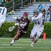 Clipper's #9 Zadoc White cuts to the net with Dover's #24 Andrew Tesch working to knock the ball from his stick during Wednesday's NHIAA DIV II Semi-Finals game between Portsmouth and Dover High Schools on 6-7-2017 @ Stellos Stadium, Nashua, NH.  Matt Parker Photos
