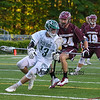 Dover's #23 Dominic Silverio gets pressure from Clippers defender #24 Ben Barba as Dover tries to set up a shot during Wednesday's NHIAA DIV II Semi-Finals game between Portsmouth and Dover High Schools on 6-7-2017 @ Stellos Stadium, Nashua, NH.  Matt Parker Photos