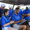 Winnacunnet's Coach Chris Sargent tallies up the scores while players and Assistant Coach Jim Blalock look on at the Winnacunnet Warriors Golf vs Nashua North and Memorial HS on Wednesday 8-23-2017 @ Sagamore-Hampton Golf Club, N. Hampton, NH.  Matt Parker Photos