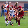 Winnacunnet's #12 Lauren Alkire goes after a ball controlled by Concord's # 5 Carly Torrance during Monday's NHIAA DIV I Girls Field Hockey game between Winnacunnet and Concord High Schools on 9-18-2017 @ WHS.  Matt Parker Photos