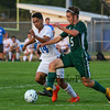 Winnacunnet's #14 Marcos Chanlatte keeps pressure on Dover's #5 Evan Dodier during Tuesday's NHIAA DIV I Boys Soccer game between Winnacunnet and Dover High Schools on 9-26-2017 @ WHS.  Matt Parker Photos