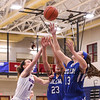 Winnacunnet's #3 Hannah Driscoll leaps for a rebound against Salem's #23 Christine Aboujaoude and #13 Jordyn Franzen at Tuesday's Girls Basketball game between Winnacunnet and Salem High Schools on 1-16-2018 @ WHS. Matt Parker Photos