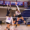 Winnacunnet's #7 Audrey Simmonds puts the ball over the net while Windham's #9 Cassandra Faria jumps to make a block at Friday's Girls DIV I Volleyball game between Winnacunnet and Windham High Schools on 10-12-2018 @ WHS.  [Matt Parker/Seacoastonline]