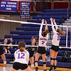 """Windham's #10 Taylor Sawyer makes a, """"kill"""" with Winnacunnet's #10 Courtney Pierce getting a hand on the ball with #7 Audrey Simmonds at the net at Friday's Girls DIV I Volleyball game between Winnacunnet and Windham High Schools on 10-12-2018 @ WHS.  Matt Parker Photos"""