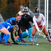 Pinkerton's #10 Sarah Collins deflects a Winnacunnet shot with Winnacunnet's #14 Carolyn Thompson and #9 Jenna Fiore applying pressure and Pinkerton's #1 Khaliyah Ellis defending the goal at Thursday's NHIAA DIV 1 Girls Field Hockey Semifinals game between #3 Winnacunnet vs #2 Pinkerton Academy on 10-25-2018 @ Exeter High School.  Matt Parker Photos