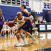 York's #21 Jackie Tabora levers her way around Marshwood defender #14 Kayla Goodwin as she makes her way to the hoop at Saturday's Class A South Girls Basketball game on 12-15-2018 @ YHS, York ME.  [Matt Parker/Seacoastonline]