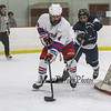 Winnacunnet defender #4 Cooper Kinnaly takes the puck around the back of the net to protect it from Saint's #27 Mathis Savard at Wednesday's Boys Ice Hockey game between Winnacunnet and St. Thomas Aquinas High Schools on 12-19-2018 @ Phillips Exeter Academy Rinks.  [Matt Parker/Seacoastonline]