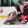 "STA-WHS's goalie #30 Shannon Abbey reacts as the puck swatted by Bedford's #5 Kendall Cassidy rolls past her pad with Abbey able to make a save and STA-WHS's #15 Skyler Bednarek defending at Wednesday's girls hockey ""9th Annual Pink Game"" between St. Thomas-Winnacunnet and Bedford High Schools on 2-14-2018 @ Dover Ice Arena, Dover, NH. Matt Parker Photos"