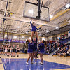 Winnacunnet Cheerleaders get a stuck ball off the rim in style, while the referee is prepared to use Katelyn Charette's crutch if all esle fails at Tuesday's Girls Basketball game between Winnacunnet and Bedford High Schools on 2-20-2018 @ WHS.  Matt Parker Photos