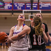 Winnacunnet Senior #25 Ashley Aversano gets fouled while driving to the hoop by Bedford's #10 Allison Morgan at Tuesday's Girls Basketball game between Winnacunnet and Bedford High Schools on 2-20-2018 @ WHS.  Matt Parker Photos