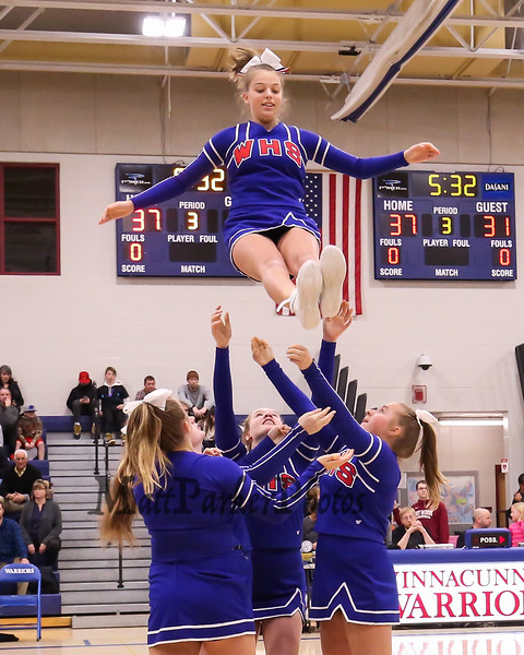 winnacunnet cheerleaders perform during a timeout at the preliminary round of nhiaa div i boys basketball