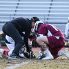 Referee Robin Day placing the ball for the face-off at the Winnacunnet Warriors Boys JV Lacrosse vs the Owls of Timberlane High School in DIV II play on Wednesday 4-11-2018 @ WHS.  Matt Parker Photos