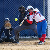 Winnacunnet's batter #12 Nicole Basil connects with the ball off a pitch by Exeter's #12 Sam Wiberg as catcher #16 Claire Perreault tracks the ball in Wednesday's DIV I Girls softball game between Winnacunnet and Exeter High Schools on 4-11-2018 @ WHS.  Matt Parker Photos