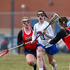 Winnacunnet's #13 Brialee Logue runs the ball up the field with Memorials #13 Jacqueline Nec trailing and another player closing in during Thursday's girls lacrosse game between Winnacunnet and Memorial High Schools on 4-12-2018 @ WHS.  Matt Parker Photos