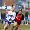 Winnacunnet's #12 Charlotte Grippo runs the ball past Memorial's #12 Chelsea Nguyen at Thursday's girls lacrosse game between Winnacunnet and Memorial High Schools on 4-12-2018 @ WHS.  Matt Parker Photos