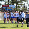Winnacunnet players head off the field after their win over Goffstown at Monday's girls lacrosse game between Winnacunnet and Goffstown High Schools on 4-23-2018 @ WHS.  WHS-15, GHS-3.  Matt Parker Photos