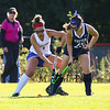 Winnacunnet's #1 Sam Crochetiere battles for the ball with Exeter's #25 Maddie Davis at Friday's DIV I Girls Field Hockey game between Winnacunnet and Exeter High Schools on 9-28-2018 @ WHS.  [Matt Parker/Seacoastonline]