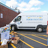 Volunteers of the St. Vincent de Paul society Food Pantry were collecting food donations with free admission to the game with the donation of two non-perishable food items to support those in need in the local communities at the Winnacunnet Warriors Football vs the Blue Hawks of Exeter High School on Saturday 9-29-2018 @ WHS.  WHS-21, EHS-7.  Matt Parker Photos