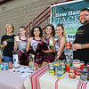 Clippers Cheerleaders (L to R) Madalyn White, Mariah Cherry, Samantha Venuto and Jadyn Noury teamed up with Gather volunteers Joanne Maldari (R) and Associate Executive Director Seneca Bernard to collect canned goods for their cause at Friday Night's football game between the Portsmouth Clippers Football vs the Red Raiders of Spaulding High School on 9-27-2019 @ PHS.  [Matt Parker/Seacoastonline]