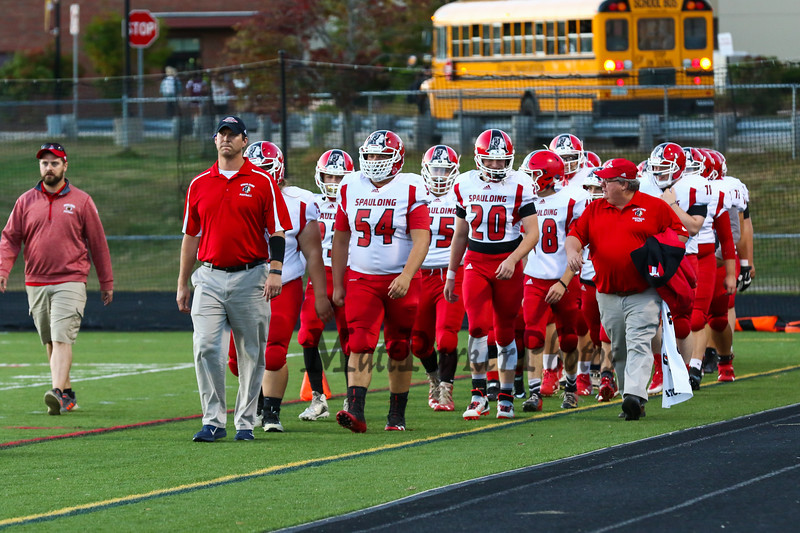 Spaulding Red Raiders players march onto the field at Friday Night's football game between the Portsmouth Clippers Football vs the Red Raiders of Spaulding High School on 9-27-2019 @ PHS.  [Matt Parker/Seacoastonline]