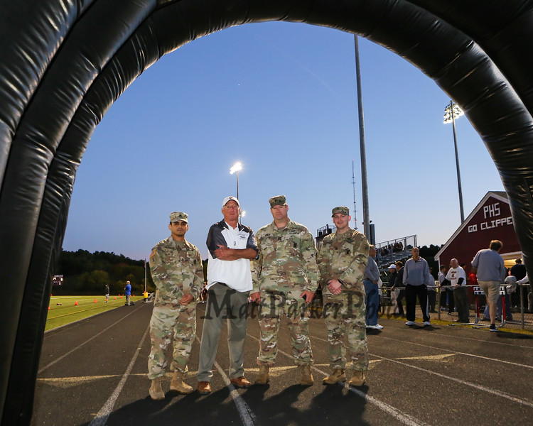 The US Army recruiters set up an entrance tunnel for the players to run through with Steven Gomrar, Clippers AD Rus Wilson, Captain James Moats and Grant Puchalla, Portsmouth Clippers Football vs the Red Raiders of Spaulding High School on Friday Night 9-27-2019 @ PHS.  [Matt Parker/Seacoastonline]