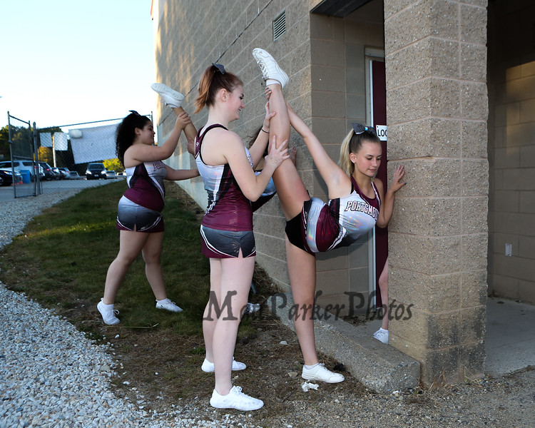 Clipper Cheerleaders stretching prior to the start of the Portsmouth Clippers Football vs the Red Raiders of Spaulding High School on Friday Night 9-27-2019 @ PHS.  [Matt Parker/Seacoastonline]