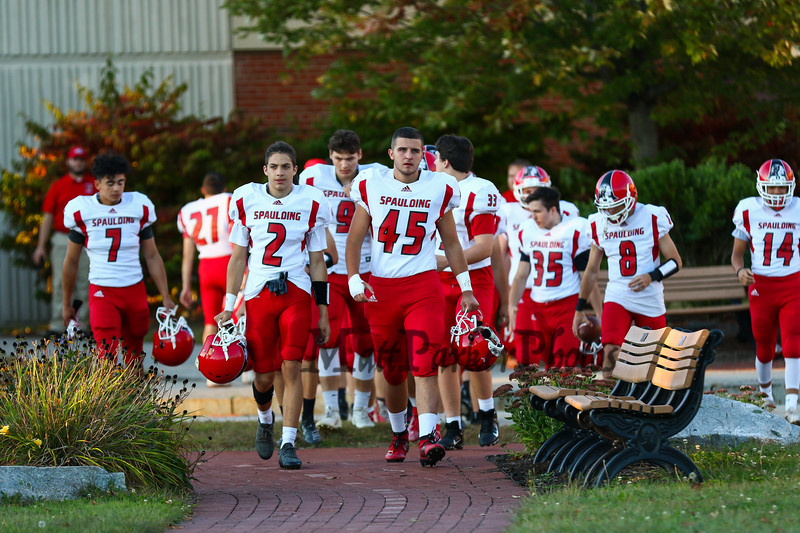 Spaulding's #45 Ryan Bernier leads his team to the field at Friday Night's football game between the Portsmouth Clippers Football vs the Red Raiders of Spaulding High School on 9-27-2019 @ PHS.  [Matt Parker/Seacoastonline]