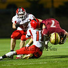 Spaulding's #11 Ryan Lane upends Clippers RB #7 Jack Russo with Spaudlings #82 Brenden Carey getting in on the play at Friday Night's football game between the Portsmouth Clippers Football vs the Red Raiders of Spaulding High School on 9-27-2019 @ PHS.  [Matt Parker/Seacoastonline]