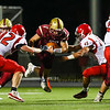 Clippers RB #7 Jack Russo jumps through a gap with Spaulding's #82 Brenden Carey and #45 Ryan Bernier reaching at Friday Night's football game between the Portsmouth Clippers Football vs the Red Raiders of Spaulding High School on 9-27-2019 @ PHS.  [Matt Parker/Seacoastonline]