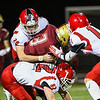 Clippers RB #3 Matthew Koener gets wrestled down by Spaulding's #20 Jacob King, #82 Brenden Carey and #11 Ryan Lane earyl in the 1st half  of Night's football game between the Portsmouth Clippers Football vs the Red Raiders of Spaulding High School on 9-27-2019 @ PHS.  [Matt Parker/Seacoastonline]