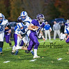 Marshwood's QB #11 Connor Caverly runs with the ball with Rams #52 Callister Montembeau looking to make a tackle at Friday Night's game between Marshwood and Kennebunk High Schools @ MHS.  [Matt Parker/Seacoastonline]