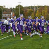 Marshwood Hawks players rush onto the field at Friday Night's football game between Marshwood and Kennebunk High Schools @ MHS.  [Matt Parker/Seacoastonline]