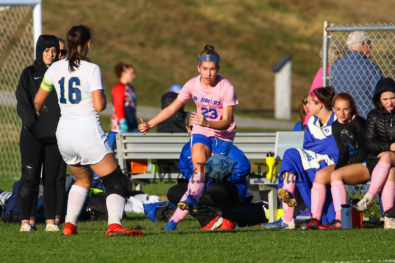 """Winnacunnet's #23 Kylee Quinlan connects with the ball, Winnacunnet Warriors Girls Soccer game on """"Kick out Cancer"""" pink Night vs the Jaguars of Windham High School on Friday 10-18-2019 @ WHS.  WHS-0, WindHS-5.  Matt Parker Photos"""