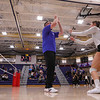 "Winnacunnet players get a ""high-Five"" after being introduced at the start of Thursday's game, Winnacunnet Warriors Girls Volleyball 1st round DIV I NHIAA playoff game vs the Cardinals of Bishop Guertin High School on Thursday 10-31-2019 @ WHS.  WHS-3, BG-0.  Matt Parker Photos"