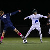 Exeter's #18 Quinn Phillips and Winnacunnet's #10 Toby Helton perform a synchronized ballet dance move on the ball at the Exeter Blue Hawk Boys Soccer game vs the Warriors of Winnacunnet High School on Friday Night 10-4-2019 @ EHS.  Matt Parker Photos