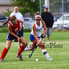 Winnacunnet's #7 Sam Crochetiere and Memorial's #17 Olivia Mack go for the loose ball at the Winnacunnet Warriors Girls Field Hockey vs the Crusaders of Memorial High School on Monday 9-16-2019 @ WHS.  WHS-2, MHS-1.  Matt Parker Photos