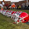 Spaulding Red Raiders helmets lined up prior to kickoff at Friday Night's football game between the Spaulding Red Raiders vs the Warriors of Winnacunnet High School on 9-20-2019 @ SHS, Rochester NH.  [Matt Parker/Seacoastonline]