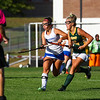 Winnacunnet's #7 Sam Crochetierre carries the ball up the field on her stick with BG's #18 Britney Pearson defending at Wednesday's girls field hockey game between Winnacunnet and Bishop Guertin High Schools on  9-25-2019 @ WHS.  Matt Parker Photos