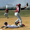 Plymouth Whitemarsh runner Ted Slagle slides safely into third base when Abington's Sean Gallagher has to go high for the throw.