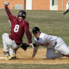 Plymouth Whitemarsh's Matt Nardo misses the tag on This steal by Abington's Brendan Gallagher.
