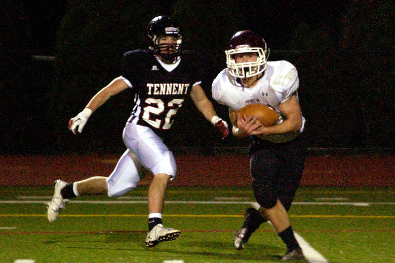 Abington's Keith Boggi pulls in a pass on the five yard line, beating out William Tennent defensive back Rob Poekert.