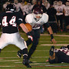 Abington's Craig Reynolds tries to break past William Tennent's Vince Wible.